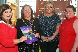 The Mayor Councillor Michaela Boyle, meeting with representatives from her two chosen charities in the Mayors parlour. Left is Marie Brown from the Foyle Womens Aid and on the right are Wenda Graham and Jennifer Hunter, with the Koram Centre in Strabane. 0619-1041MT.