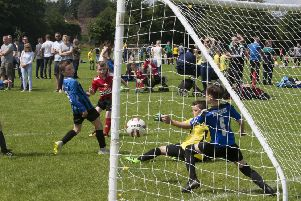 The Oxford United goalkeeper can do nothing to stop this shot on Monday in the 2019 O'Neills Foyle Cup. (Photo: Jim McCafferty)