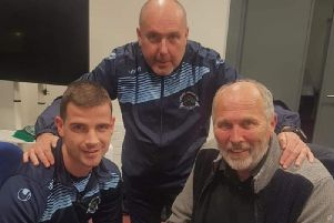Institute defender Conor Tourish pictured with Sean Connor (Manager) and Bill Anderson (Chairman), signing his PRO contract.