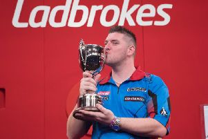 Daryl Gurney celebrates winning last year's Ladbrokes Players Championship title.