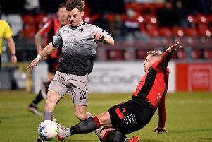 Institute's Aidan McCauley tries to get away from Crusaders' David Cushley.