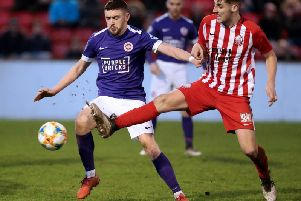 Left-back Dean Jarvis (left) admitted Storm Ciara made life tough at the Ryan McBride Brandywell Stadium on Saturday.