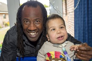 Children's TV presenter Sid Sloane with 6 year old Harvey who is receiving special care at The Children's Trust. EMN-160915-090112001