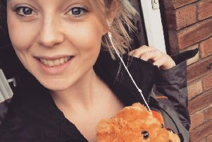 Sophie Bole heads out for a run with her Red Arrows teddy EMN-180326-125023001