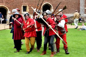 Re-enactors gettng ready for battle at last year's event