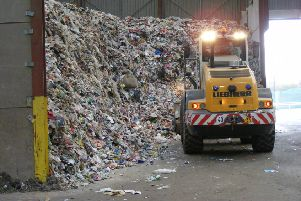 Mountains of recyclable waste waiting to be sorted at Mid Uk's plant. EMN-180919-095748001