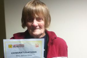 Janice Dilks with a certificate signed by the charity's CEO Karen Jobling
