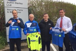 From left, Colin Darke (business owner), Keith Snape (Matthew Mansey's grandfather and Darke's customer), Matthew Mansey (Louth Town coach), Paul Wooding (Darke's. sales director) with home kit, goalkeeper top and training jumper EMN-190804-124715002