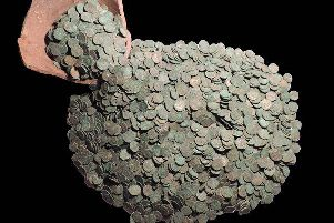 The Roman coin hoard and fragment of pot that it was buried in, near Rauceby.