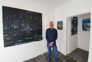 Chris Beasley with some of his contemporary artwork at the new gallery.