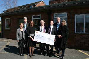 Chairman of the Louth Scanner Appeal, Trevor Marris, with other fundraisers presenting the cheque to ULHT Chair Elaine Baylis and other representatives from the Trust.