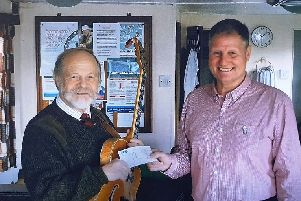 Band member Phil Trevethick with Alastair Brown from Prostate Cancer UK.