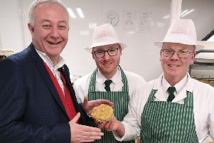 One of last year's guest judges, auctioneer Colin Young, pictured visiting Woolliss & Son in Louth. (Picture: Louth Pie Day)