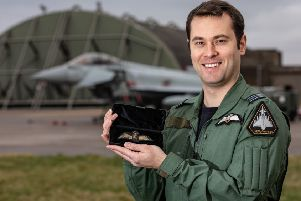 RAF Typhoon Pilot Flt Lt Brighty with the wings in front of his Typhoon. EMN-200124-141338001