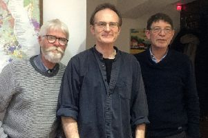 Chris, David and Pete (pictured together in 2018) have 'virtually' revived their rock band.