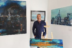 Chris Beasley with some of his own artwork at the gallery in Aswell Street.