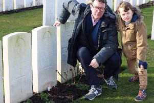 Gavin McAlinden with his son Shay at the grave of Private James Furphy