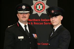 Firefighter Jamie Dayer from Moira with Chief Fire & Rescue Officer Gary Thompson.
