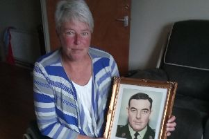 Andrea Brown with a photograph of her late father, RUC Sergeant Eric Brown, who was murdered by the IRA in January 1983