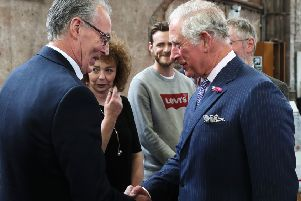 The Prince of Wales shakes hands with Sinn Fein MLA Gerry Kelly as her colleague Caral Ni Chuilin (second left) looks on at Carlisle Memorial Church in Belfast
