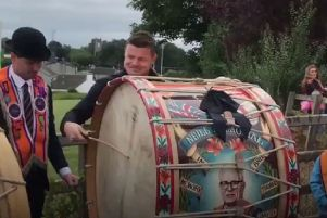 Ex-Ireland rugby captain, Dubliner Brian O'Driscoll, beating a Lambeg drum on the Twelfth, 2018, at Loughgall. (Still image taken from BBC footage)