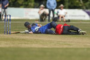 Waringstown wicket keeper colliding with Ciyms Nigel Jones