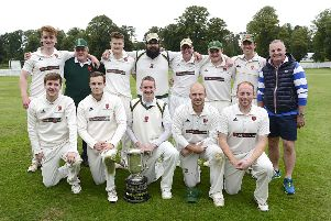 Lisburn captain Adam Berry and team members pictured with the trophy. Picture By: Arthur Allison.