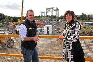 Lord Mayor of Armagh City, Banbridge and Craigavon, Councilor Julie Flaherty views the site of the New Leisure Centre with Project Manager Dwaine Rice.