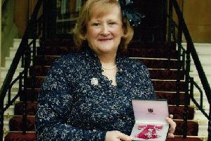 Former RUC officer Joyce Crossan with the MBE she was awarded in 2009