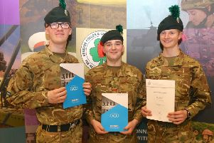 Showing off the certificates which mark their latest achievements are, from left, 16-year-old Cadet Corporal Ben Dowey and 17-year-old Boaz Hughes who earned ILM Level 2 Awards and 16-year-old Cadet Lance Corporal Nathaniel Cunningham who achieved Silver in the Duke of Edinburgh Awards and who already has his eyes on Gold.