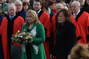Kate Carroll (widow of Steve Carroll) lays a wreath with Yvonne Black (widow of David Black) during a memorial service in Antrim this week.
