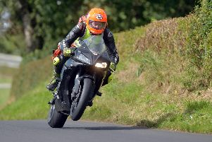 Dr John Hinds pictured on duty at the Mid Antrim 150 road races in 2013. The travelling doctor was just as well known as many of the riders he volunteered to provide care for as part of the MCUI Medical Team.