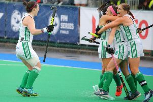 Bethany Barr mobbed by team-mates following a goal for Ireland on her major tournament debut during Saturday's defeat of Malaysia in Banbridge