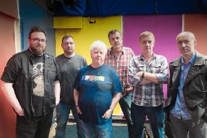 Stuart Neville, left, with band members Mark Billingham (vocals/guitar), Chris Brookmyre (vocals/guitar), Doug Johnstone (drums), Val McDermid (vocals), and Luca Veste (bass)
