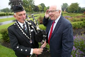 Winston Pinkerton, President of the Northern Ireland Branch of the Royal Scottish Pipe Band Association 'pipes a tune' for Alderman Allan Ewart MBE, Chairman of the council's Development Committee at the launch of the Lisburn & Castlereagh Pipe Band Championships that will take place in Moira Demesne on Saturday 10th August.
