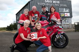 Adam McLean and UGP Clerk of the Course, Noel Johnston join Injured Riders' Welfare Fund members Jan Simm, Sharon Neill, Sheila Sinton and Susan Lester to annouce the Fund collected a record �13,900 as the  chosen charity of the fonaCAB Ulster Grand Prix' in 2019