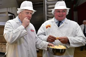 Prime Minister Boris Johnson sampled some of Northern Ireland's favourite crisps during his visit to the Tayto factory in Tandragee