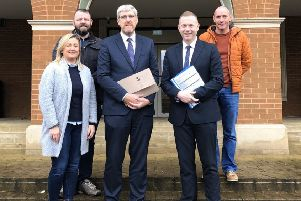 Sinn Fein MLA John O'Dowd on the Westminster campaign trail  with party colleagues Chris Hazzard MP, Sinead Ennis MLA and election support staff.