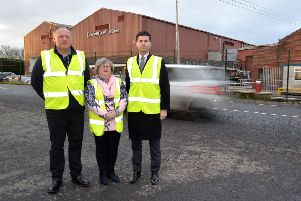 Highlighting the road safety problems for workers at golden Cow Dairies, Artabrackagh Road, are from left, Paddy McAlister, operations manager, Joy Mc Farland, health and safety manager, and local MLA, Jonny Buckley. INPT49-203.