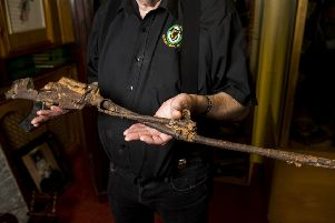 Kevin Carson, curator of  Roddy McCorley Society living history museum in Belfast holds the mangled metal frame of an L1A1 Self-Loading Rifle. The gun was reportedly found on the Omeath foreshore approximately a year after the Narrow Water IRA attack that killed 18 soldiers. Photo: Liam McBurney/PA Wire