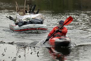 Jon Medlow in his kayak with just some of the rubbish he has collected from the River Bann