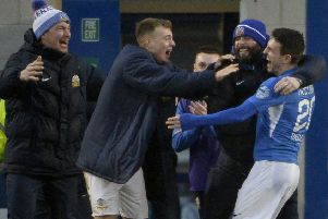 Conor McCloskey heads over to the Glenavon dug-out following his winning goal against Crusaders at Mourneview Park. Pic by INPHO.