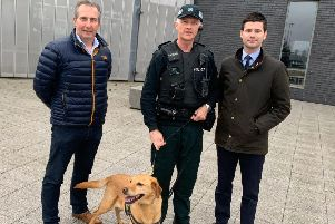 Councillor Lavelle McIlwrath, Inspector Leslie Badger and Jonathan Buckley with PSNI Service Dog.