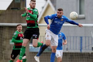 Rory Donnelly (left) and Colin Coates competing on Saturday in the 2-2 draw at Mourneview Park between Glenavon and Glentoran. Pic by Pacemaker.