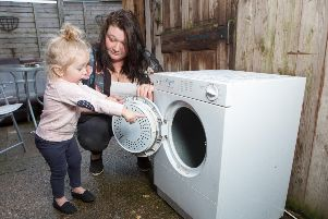 Little Iiylah-Louise was playing when she opened the door of the dryer and got her finger caught on a blanket as it sped round the drum.