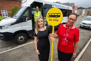 Redrow sales assistants Emma Clark and Rachel West stand with bus driver Peter Waller at the Redrow Caddington Wood development near Luton. Credit: Matthew Power.