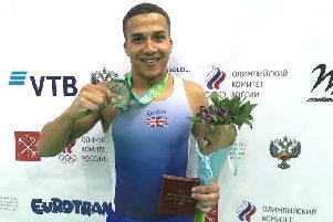 Elliot Browne celebrates with his silver medal - pic: British Gymnastics