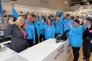 Cancer survivor Denise Coates with the Dunstable team at the shop opening.  Photo by: Sean Dillow. www.TheBigCheesePhotography.co.uk
