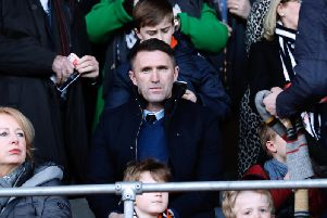 Ireland assistant coach Robbie Keane watches on at Kenilworth Road