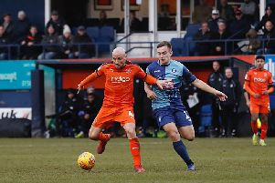 Alan McCormack holds off a challenge against Wycombe on Saturday